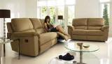 Woman sitting on furniture village sofa