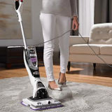 Woman vacuuming with shark vacuum cleaner